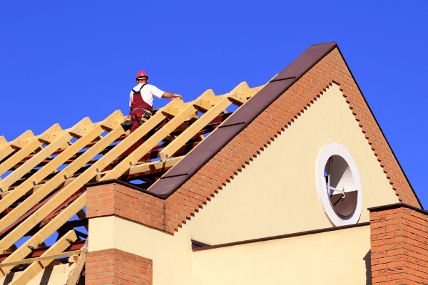 This is a picture of a roofer doing his roof repair job.